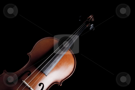 Violin stock photo, Medium shot of violin over dark background by iodrakon