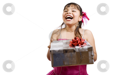 I wonder what I got this time.... stock photo, Studio shot of endearing girl with gift wearing fancy dress - focus on gift by iodrakon