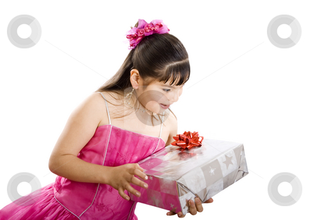 I wonder what I got this time.... stock photo, Studio shot of endearing girl with gift wearing fancy dress - Isolated on white by iodrakon