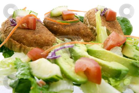 Mexican empanadas stock photo, High key closeup shot of Mexican empanadas with traditional salad - selective focus on center empanada by iodrakon