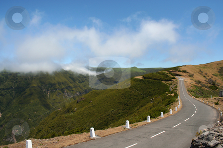 Road on Paul de Serras plateau stock photo, The Paul De Serras plateau, Madeira, has an average height of 1200+ metres. The cloud levels are often below the top of the plateau so you feel like its the top of the world. by Helen Shorey