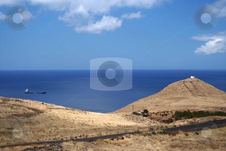 Lonely Oil Tanker stock photo, Oil tanker heading for Funchal docks, Madeira. Wild and rugged coastal area near Ponte de Castelo. by Helen Shorey