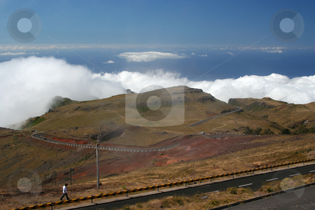 Above the clouds stock photo, View from Pico de Areairo, the second highest point on Madeira but the highest point for vehicles. Looking out over the Atlantic ocean, the human and the car give a sense of the scale. by Helen Shorey