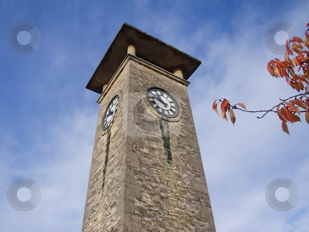 Clock tower stock photo, Clock tower with sky background and branch in Nailsworth England United Kingdom by Jaime Pharr