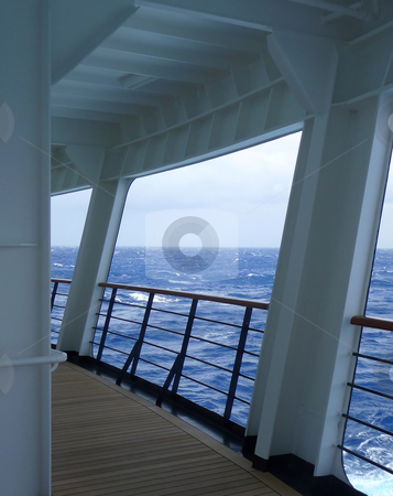 Open view from rear of cruise ship to the ocean stock photo, An empty walking deck on the rear of a cruise ship by Jill Reid