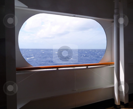 Open view to ocean from side of ship stock photo, A large open window provides a view to the sea and sky by Jill Reid
