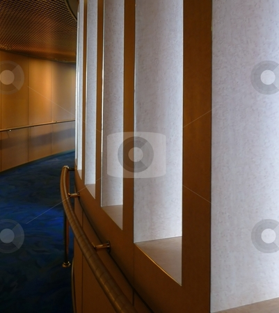 Curved open wall in corridor stock photo, A curved wall with openings along a corridor by Jill Reid