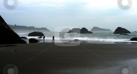 People playing on the beach stock photo, Having fun on a sandy beach on the coast of Oregon by Jill Reid