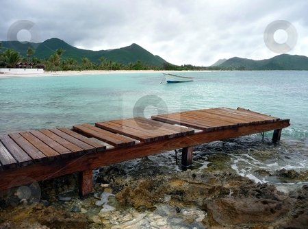 Weathered pier on caribbean island stock photo, A weathered wooden pier juts into the clear water of a caribbean island by Jill Reid