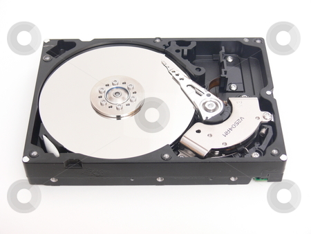 Hard drive    stock photo, An open hard drive with the 3 disc and the writing finger. by Horst Petzold