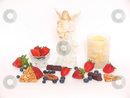 Strawberry, candles, Maria, chocolate, blueberry    stock photo, An display of fruit, a round candle holder and Maria with Jesus on white background. by Horst Petzold