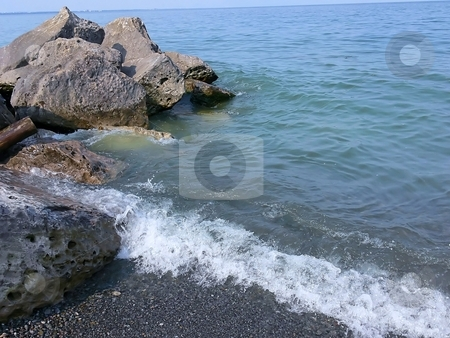 Lakeshore     stock photo, A small white wave with gray rocks on the shore of lake Ontario. by Horst Petzold