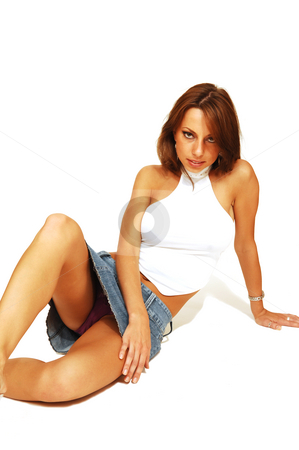 Sitting woman in short skirt. stock photo, An very fit woman in a short skirt and white top sitting on the floor in an   studio for white background and shooing her great figure. by Horst Petzold