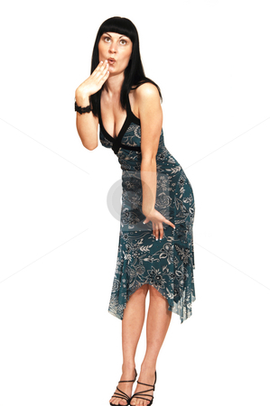 Standing woman in blue green dress. stock photo, A young pretty woman standing on the floor and having fun for white background and shooing her great figure. by Horst Petzold