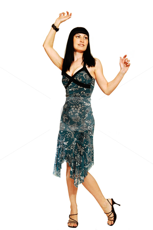 Standing woman in dress. stock photo, A young pretty woman standing on the floor and having fun for white background and shooing her great figure. by Horst Petzold