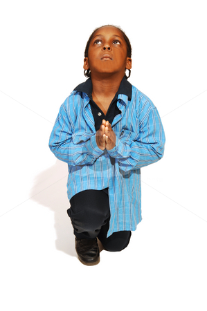 Young Jamaican boy. stock photo, A friendly young Jamaican boy praying in the studio and enjoying the photo session. by Horst Petzold