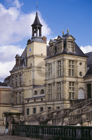 The clock tower and staircase at Chateau de Fontainebleau stock photo, Clock tower and serpentine staircase, Chateau de Fontainebleau by GB Tittle