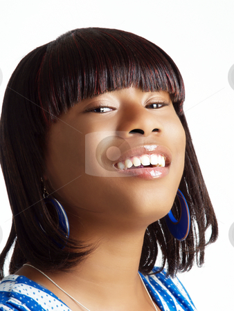 Young black woman with head tilted back stock photo, Young black woman with big smile head tilted back by Jeff Cleveland