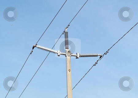 High tension electrical lines and pole against blue sky stock photo, High tension wires, pole and arms against blue sky by Jeff Cleveland
