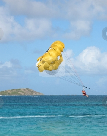 Parasailing in the Caribbean stock photo, A view of parasailing in the Caribbean, just off the island of St. Maarten on a beautiful afternoon in January by Ray Carpenter