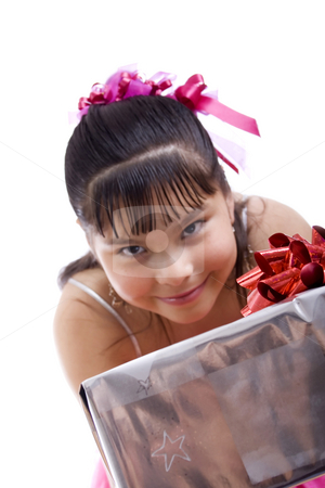 I have a gift for you... stock photo, Studio shot of endearing girl with gift wearing fancy dress - focus on gift, Isolated on white by iodrakon