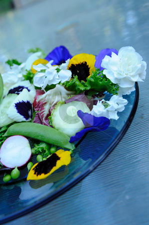 Salad And Edible Flowers stock photo, Fresh salad and edible flowers, including snap peas, pansies, carnation, cucumber, lettuce by Lynn Bendickson