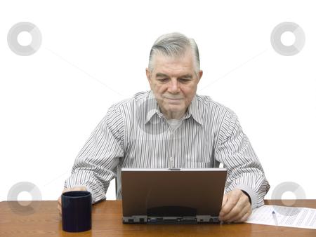 Senior working on Laptop stock photo, Senior working on laptop on white background by John Teeter
