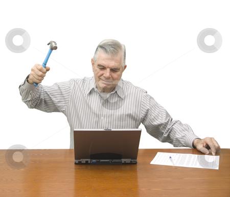 Senior with hammer and laptop stock photo, Senior with hammer and laptop on a white background by John Teeter
