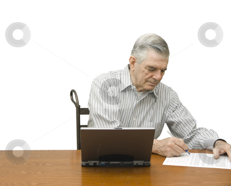 Senior writing with laptop stock photo, Senior writing with laptop on a white background by John Teeter
