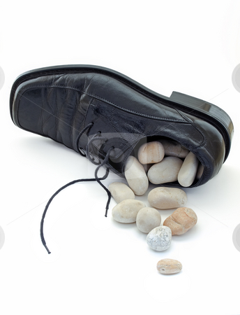 Stone in the shoe stock photo, Metaphor about problems like  small stone at the bottom of shoe.What to do when it is full, and they are no longer small by Sinisa Botas
