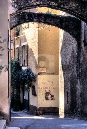 Archways span narrow street in St Paul de Vence, Cote d'Azur stock photo, Street in St Paul de Vence above Riviera, Alpes-Maritimes, France by GB Tittle