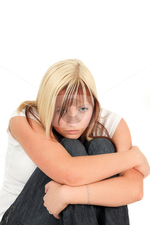 Depression stock photo, Young, depressed girl is sitting with sad face on white background by Tom P.