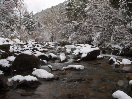 Winter River stock photo, A color image of a mountain river during winter. by Michael Rice