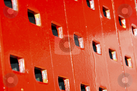Background - red support platforms in stacks stock photo, Stacks of painted red metal support platforms used for construction by Chris Alleaume