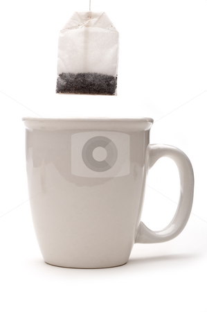A vertical view of a teabag over a white cup stock photo, A vertical view of a teabag over a white cup by Vince Clements