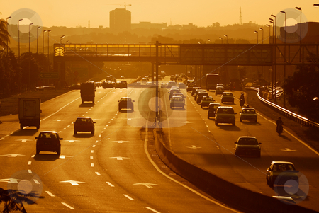 Busy Highway stock photo, Highway during sunset by Jaggat Images