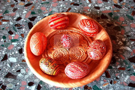 Easter egs with a plate stock photo, Easter eggs on a wooden plate isolated in a naional style by Alexey Rumyantsev