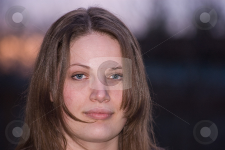 Beautiful Young Caucasian Early 20's Woman stock photo, This is a closeup of a beautiful Caucasian woman in her early 20's, with a sunset in the background.  She has blue eyes and long brown hair. by Valerie Garner