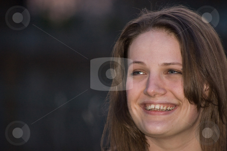 Pretty Young Woman Smiling at Dusk stock photo, Pretty young adult woman is smiling an authentic smile at dusk for this lovely photo. by Valerie Garner