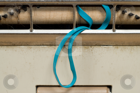 Tangled Powerhead stock photo, An elastic band is tangled up in a vacuum cleaner by Richard Nelson