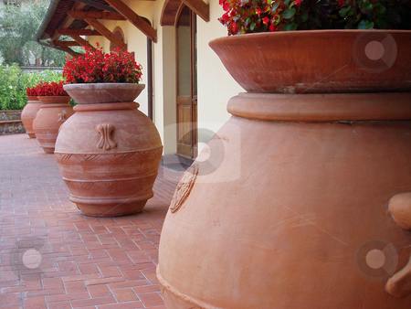 Terracotta urns stock photo, Terracotta olive oil urns being used as flower pots by Jaime Pharr
