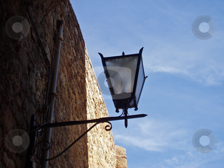Lamp and brick wall in Tuscany      stock photo, Lamp and brick wall in Tuscany Italy by Jaime Pharr