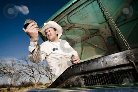 Man under the hood of his car stock photo, Man in cowboy hat under the hood of truck by Scott Griessel
