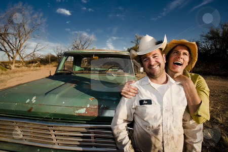 Couple with a Pickup Truck stock photo, Man and woman in cowboy hats with old truck by Scott Griessel