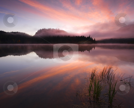 Heavens Unfolded stock photo, A glorious sunrise of the mist covered still waters of Clear LAke by Mike Dawson
