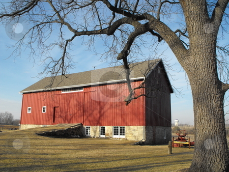 The Red Barn stock photo, Urban sprawl is encroaching on this scenic red barn on the edge of Cedar Falls, Iowa but it still looks ready for use 100 years later. by Dennis Thomsen