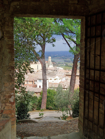 San Gimignano through doorway stock photo, View of San Gimignano through garden doorway by Jaime Pharr