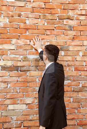 Businessman by brick wall stock photo, Businessman hand in suit standing by brick wall by Julija Sapic