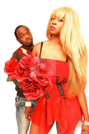 Young black couple. stock photo, African American couple have a fight at home and the husband like to make it up with red roses. by Horst Petzold