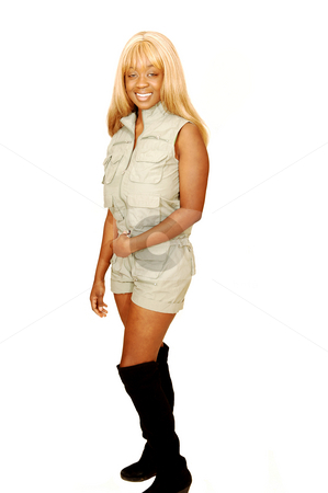 Young Jamaican girl safari overall. stock photo, An blond young Jamaican girl in an safari overall and long brown boots for white background. by Horst Petzold
